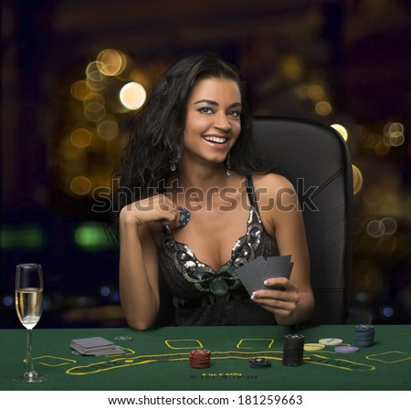 brunette girl in the casino playing poker, bokeh - stock photo