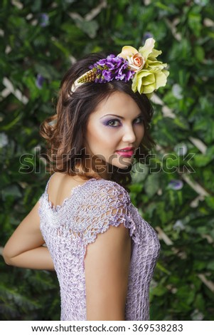 Brunette girl with flowers, close up shot  - stock photo
