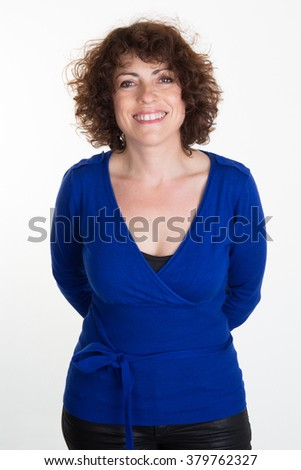 Brunette in a blue top  with f against white background - stock photo