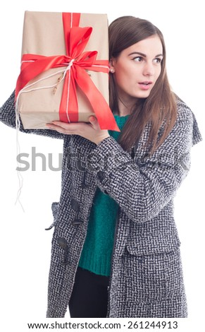 Brunette in a gray coat and a great gift(isolated on white) - stock photo