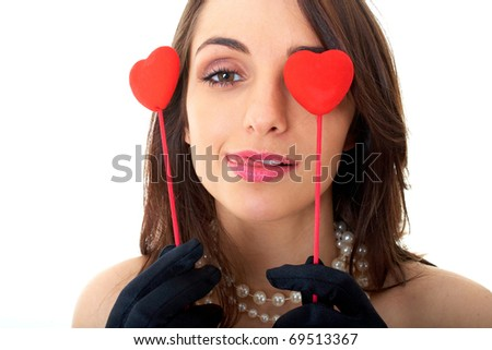 brunette in red dress holds two hearts, isolated on white - stock photo
