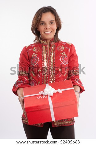 Brunette in red holding a gift box of the same color - stock photo