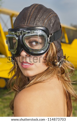 Brunette model posing with a WW1 aircraft - stock photo