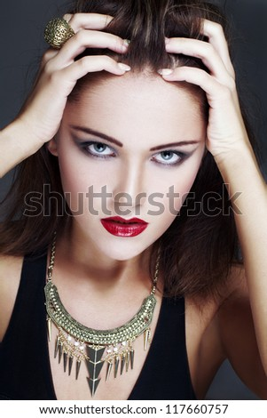 Brunette model touching head, high end fashion portrait - stock photo