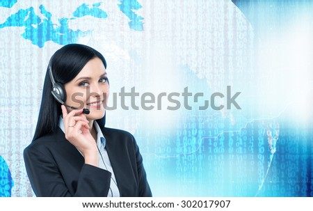 Brunette support operator in headset and digital world with binary code on the background. Elements of this image furnished by NASA. - stock photo
