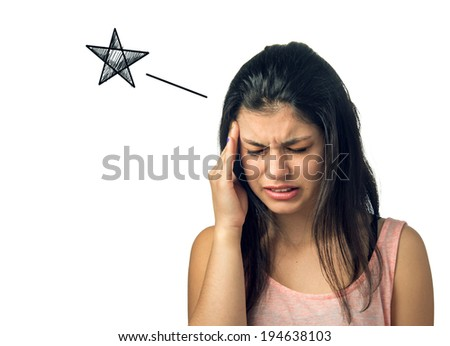 Brunette teenager girl with painful expression and hand on her head - stock photo