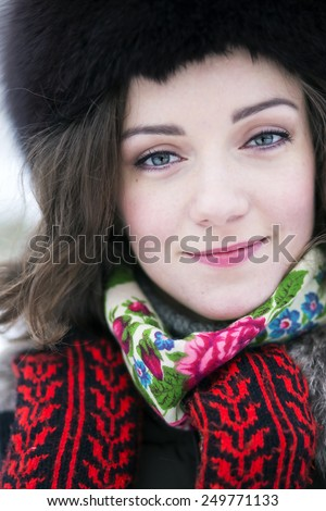 Brunette with a beautiful blue eyes smiling at the camera - stock photo