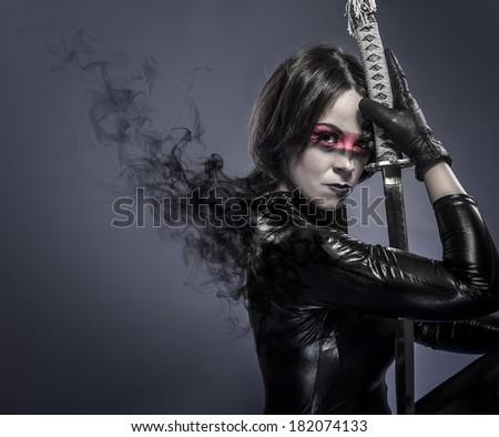 Brunette with katana sword, fineart - stock photo
