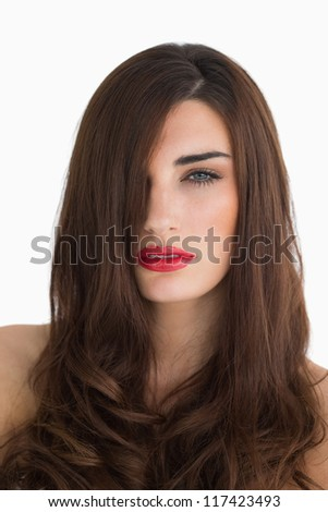 Brunette with red lips having long brown hair - stock photo
