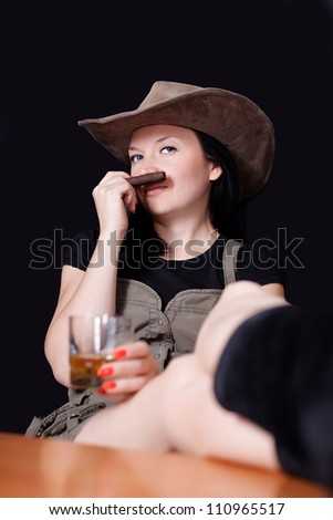 Brunette with whiskey and cigar in hand dark background - stock photo