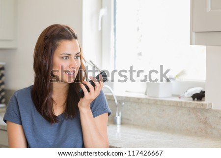Brunette woman calling with her smartphone - stock photo
