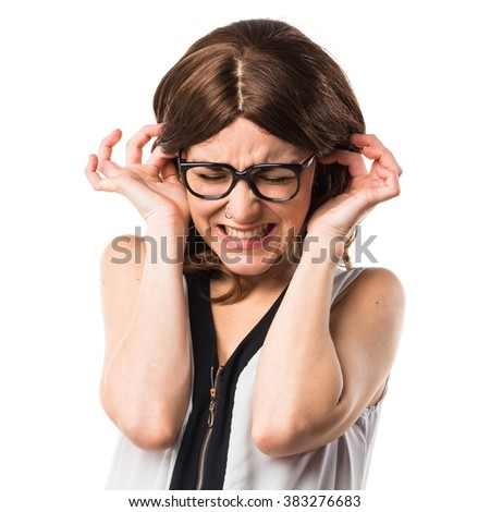 Brunette woman covering her ears - stock photo