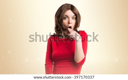 Brunette woman doing vomiting gesture - stock photo