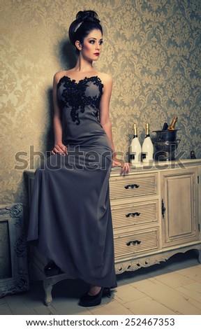 brunette woman in an elegant dress - stock photo