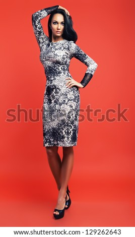 brunette woman in black and white dress - stock photo