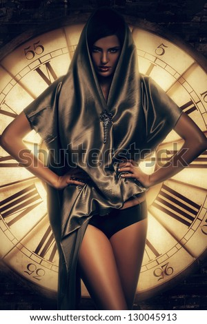 brunette woman in cape and clock - stock photo