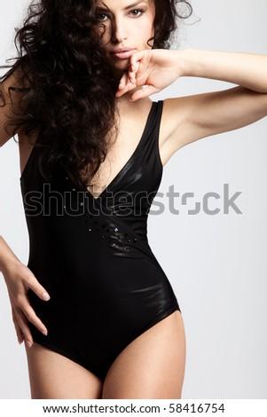 brunette woman in swimsuit studio shot - stock photo