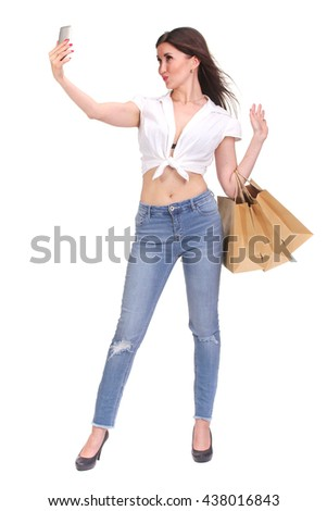 Brunette woman making selfie with shopping bags - stock photo
