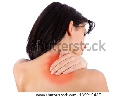 Brunette woman massaging her shoulder because it hurts. - stock photo