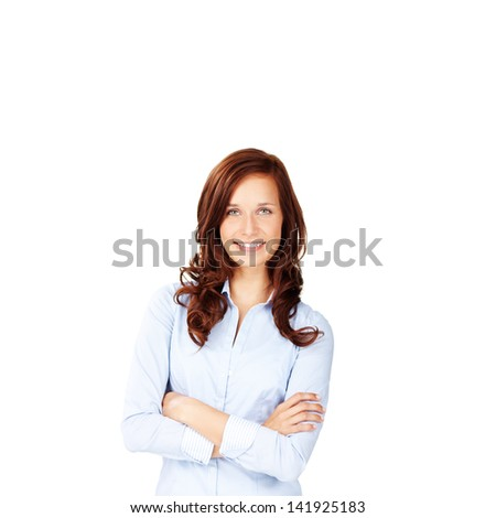 Brunette woman posing with arm crossed over the white background - stock photo