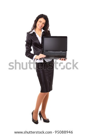 Brunette young businesswoman showing a laptop screen with copy space - stock photo