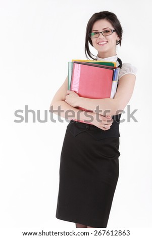 Brunette young woman in glasses with colorful folders isolated on white - stock photo