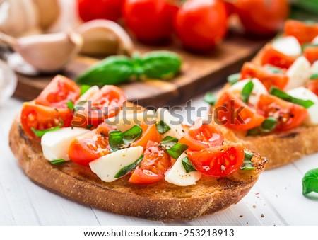 Bruschetta with cherry tomato and mozzarella - stock photo