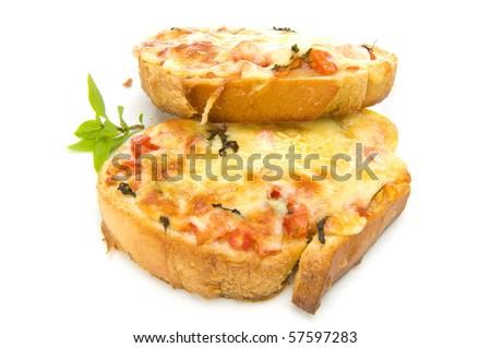 Bruschetta with fresh tomatoes, cheese and basil. - stock photo