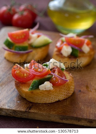 Bruschetta with juicy vegetables, selective focus - stock photo