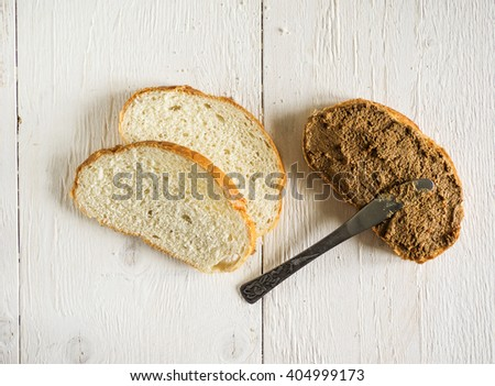 Bruschetta with liver pate on old wooden weathering background - stock photo