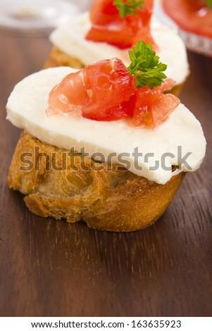 Bruschetta with mozarella and tomatoes - stock photo