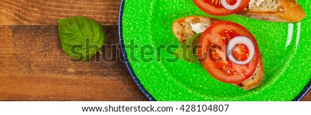 Bruschetta with Tomato, Cream Cheese and Basil. Panoramic image. Selective focus. - stock photo