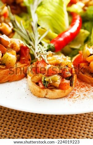 bruschetta with vegetables - stock photo
