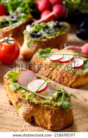 Bruschettas sandwich with pesto and radish,selective focus - stock photo
