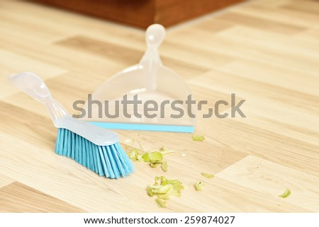 Brush and dustpan for sweeping - stock photo
