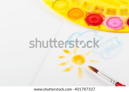 Brush and painting with the sun - stock photo