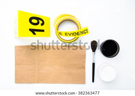 brush and paper bag for latent fingerprint search tool in crime scene isolated on white background - stock photo