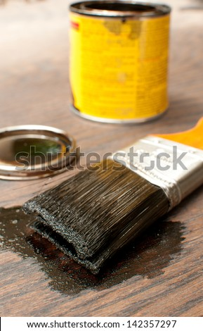 Brush for painting wood in darker tint - stock photo