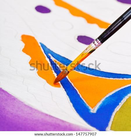 brush painting of cold batik geometric ornament close up - stock photo
