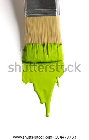 Brush with green paint on a white background - stock photo