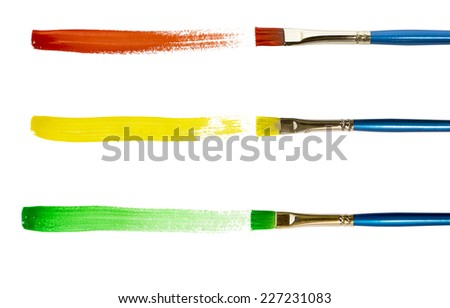 Brush with red,yellow and green paint stroke and stick, cut out on white.  - stock photo