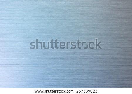 Brushed metal, blue tone. - stock photo