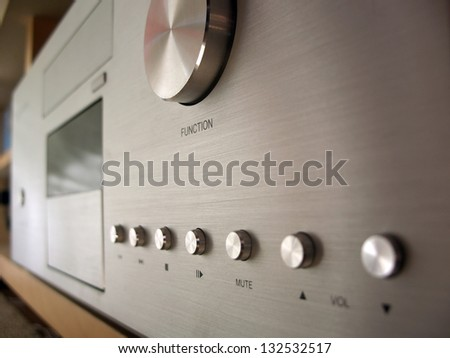 Brushed metal home theater pc close up of play buttons and selection knob, focus on play button - stock photo