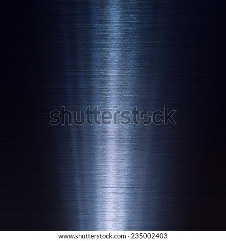 Brushed metal texture in the dark with intense slitted lighting in middle.  - stock photo