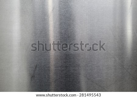 Brushed Metal texture with lighting and lens ghost - stock photo