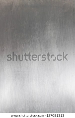 Brushed silver metallic surface background - stock photo