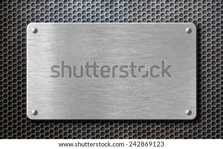 brushed steel metal plate background with rivets - stock photo