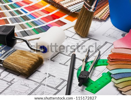 brushes and accessories for repair to architectural drawing - stock photo