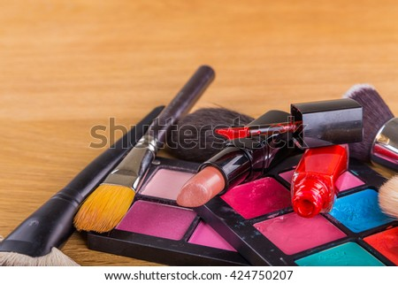 Brushes and shadow and other make-up accessories - stock photo
