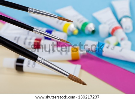 Brushes for painting and acrylic paints in tubes - stock photo